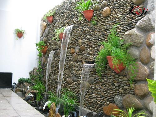 Thác nước tường là một trong số hạng mục chi phí thi công sân vườn